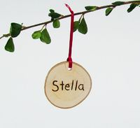 Personalized gift rustic wooden Christmas ornament- natural Red Holiday decor. $6.00, via Etsy.