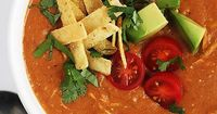 Creamy chicken enchilada soup made in the crockpot! Easy, healthy and crazy delicious!