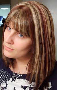 this is EXACTLY how I want my hair highlighted!! red and blonde highlights in dark brown hair. perfectly spaced, and not all blended in together! <3