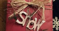 Country Christmas Wrap...add twine or raffia to plain paper and rustic embellishments to finish it off.