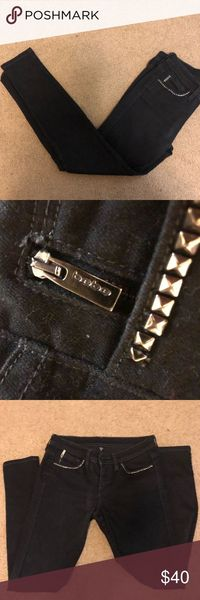BEBE- black pants with studded pockets Size 28 Comfortable to wear! Has studs lining the front pockets and also the back pockets In great condition bebe Pants Skinny