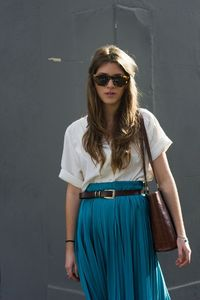 Blue pleated skirt. White top