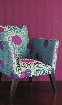 Pairing a beautiful jewel-toned floral chair against deep magenta wallpaper makes a bold statement!