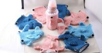 Baby Bottle Shark Cozy   34 Gifts For The Coolest Baby You Know .....so she can be just like her dad!