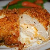 """""""Not your everyday chicken dish! Stuffed with Cheddar and cream cheeses, then drenched with a garlic-lemon-butter sauce, your friends and family will be begging you to make this recipe - believe me, I know!"""""""