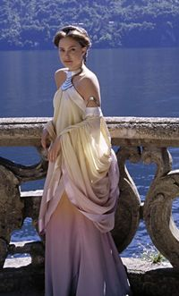 Arguably the most iconic of Amidalas costumes from Attack of the Clones, this ombre-dyed silk dress with metal and mother of pearl accents is worn by Natalie Portman as Padme Amidala upon her and Anakin's arrival at the lake retreat on Naboo.