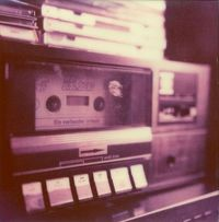 Casette tape player - ( Longing Sigh ) Ahhh i miss the good 'ol silly mixes i had, You know the ones where your never really sure where one song begins and the other one leaves off -Or nO! Better Yet, all those ones i taped off the radio stati...