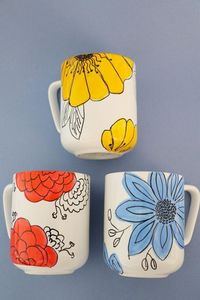 Update basic mugs with large, colorful flowers to bring a splash of summer to your morning coffee routine.
