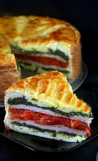 Tourte Milanese - layers of herbed eggs, ham or turkey, cheese and vegetables encased in puff pastry. A great main dish stunner and easy!