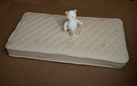 Buy extra firm baby crib mattress featuring organic cotton ticking and