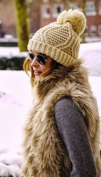 knit beanie and fur vest
