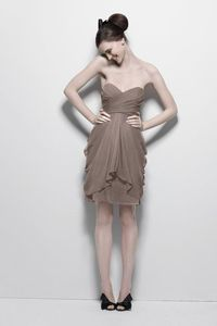 I love this dress, but this poor girl looks like she's about to have a wardrobe malfunction!