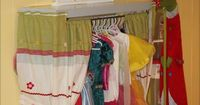 Ikea dress up station. The guy did it for 100 dollars but idk how he spent that much. Just get a shelf and use some pvc piping as a curtain rod for the drapes. Get some cutesy fabric for the drapes and voila. Probably would cost less than $25 that way.