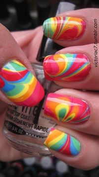 Ive GOT to try this!!! -get a bowl of water, pour little bits of all the different shades you want, it should float on the top, swirl with a toothpick or something like it and when it looks like you want on top of the water, then dip your nails through th...