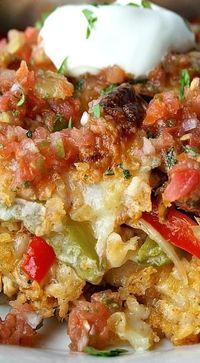 Chicken Fajitas Casserole ~ Layers of tortilla, Spanish rice, smoky chicken, and sautéed peppers and onions, all tied together with a super-cheesy queso sauce
