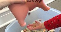 This Piggy Bank Sensory Bin for kids uses real money! Coins are shiny, smooth, heavy for their size and make a great sound. A Perfect Sensory Bin Filler!