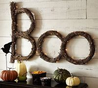 Lit Twig Boo Sign #potterybarn, but you can make this too... 4 circles total paint it black, 2 for a swag branch for the letter B, add some lites and a crow!