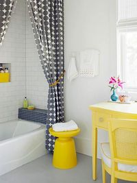 TREND: Bright pops of color and strong graphic patterns Getting ready each day in this bathroom would probably put you in a pretty cheerful mood! The shell of t