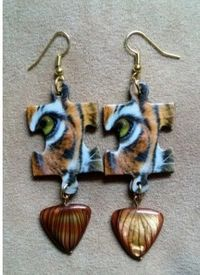 Regalia Earrings is a leading place to buy eye of the Tiger in the USA from Regalia Earrings. To grab this product visit here now! https://regaliaearrings.com/collections/tiger-collection/products/fierce