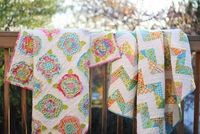 Brother and sister quilts -- same fabric, yet definitely different. Really great idea!