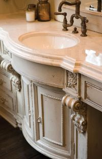 Master Bath Designs - I like the old world design and look of this cabinet for a bathroom