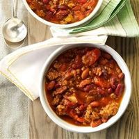 Sandy's Slow-Cooked Chili; has a thing or two I usually don't add, but why not try? May even add something!!