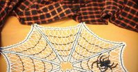 Urban Threads Tutorials | Haunt your house with this lace spiderweb design! Stitch cottony lace triangles, then assemble them into the creepiest of doilies.