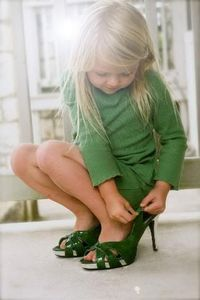 The love of shoes starts early, especially if they are Mom's and they are green.....................