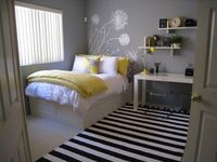 """i like this color for natalie's room. the paint is by BMoore, """"pigeon gray"""". shelves are West Elm and the rug is PB teen. love this spaces."""