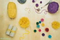 Use a fork and toilet paper rolls to create size XS and XL fluffy pom poms