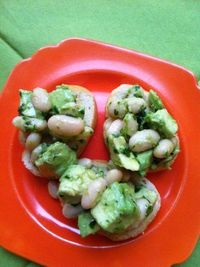 Rustic Avocado And Cannellini Bean Crostini With Gremolata...gremolata is a parsley sauce with lemon zest and garlic!