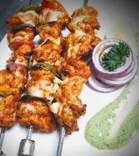 Chicken kebab recipe made with tandoori masala and mozzarella cheese baked till crisp and juicy.