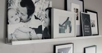 Photo Ledges O Fun - love the mixture of canvas with framed art and photos...for the catwalk?