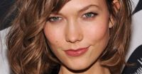 Karlie Kloss's hair looks fabulous and easy breezy and ......... OHMYGODWHYCAN'TIPULLOFFBANGS? That is all. {Go Fug Yourself}