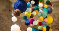 34 Things To Do With Leftover Bits Of Yarn | Yarn Ball Backdrop | Wrap styrofoam balls wrapped with yarn leftovers.