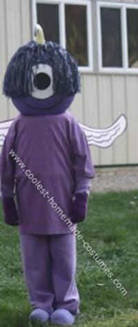 Homemade Purple People Eater Costume: My daughter came up with the idea of a Purple People Eater Costume. To make this costume I paper mached a punching ballon for the head, we used newspaper