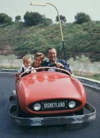 Walt Disney, daughter Diane and grandson Christopher have fun in Disneyland, 1957.