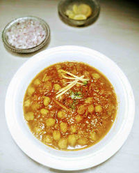 Chole recipe made from overnight soaked chickpeas. Boiled and cooked with tomato onion gravy with lots of spices. Make this chickpeas curry from scratch.
