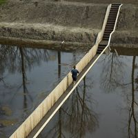 Dutch bridge that sinks below the water rather than rising above it
