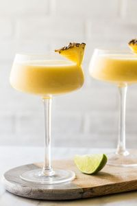 Frozen Pineapple Mango Daiquiris are going to be your new favorite cocktail for summer. Smooth, cool, and oh, so delicious! from