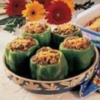 Chili-Stuffed Pepers 6 medium green bell peppers 1 pound ground beef 1/2 cup chopped onion 1 (15 ounce) can chili beans, undrained 1 (10 ounce) can diced tomatoes and green chilies, undrained 1 teaspoon chili powder 1/2 teaspoon salt 1/4 t...