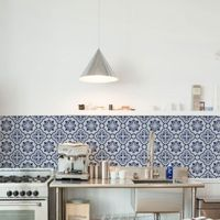Top to bottom, left to right: Delft tiles bring a charming counterbalance to the industrial kitchen Ceramicist Lucile Sciallano's sheds light on her creative pr