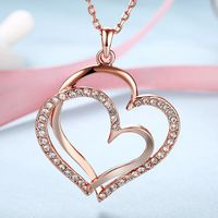 Curved Duo Intertwined Heart Shaped Swarovski Elements Necklace in 14K Rose Gold $18.00