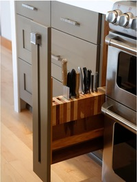 Skinny pull out cabinets for knives and spices in the kitchen.