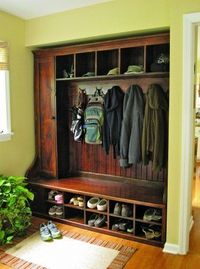 possible coat closet idea? (i love the dark wood, a place for everything, coats, hats, shoes and boots, long cabinet on the side, and a bench to sit down (with a rug in front - needed) - this is perfect .... if only i had an entry! might be ab...