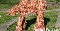 WTF. It's a bacon AT-AT. Three feet tall, made from more than 40 lbs of bacon, and 21 non-stop hours of love (mental illness) to construct.