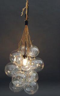 DIY: Glass Orb Cluster Light: Remodelista John Giacomazzi, the owner of home and garden store Area in San Francisco and a designer himself, sent us this fantastic DIY Glass Globe cluster light he recently put together. He also sent step-by-step instructio...