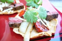 Put a little sizzle in your summer with these easy and savory steak fajitas! Grassfed skirt steak is a delicious and economical cut of beef that grills beautifu