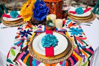 Super colorful place setting..Love center pieces. Paper flowers with colorful metal candle lanterns