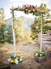 I love the natural backdrop and the birch wood arch compliments the forestry already surrounding the venue!
